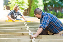 Carpenters Working At Construc...