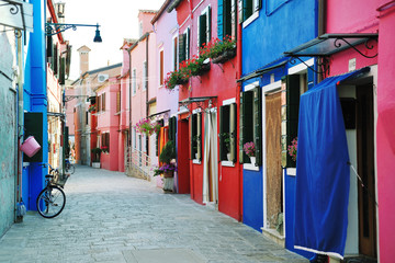 FototapetaColorful buildings in Burano island street, Venice