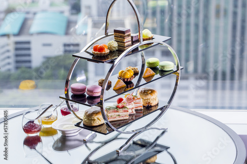 Fototapeta A afternoon tea set consisting of a collection of pastries obraz