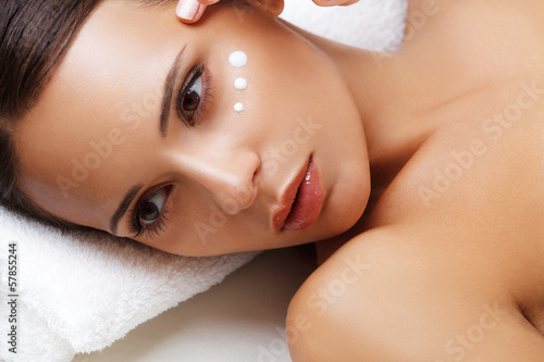 Poster  Close-up of a Young Woman Getting Spa Treatment. Cosmetic Cream