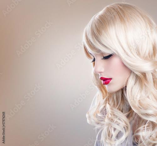 Fotografie, Tablou  Blonde Woman Portrait. Beautiful Blond Girl with Long Wavy Hair