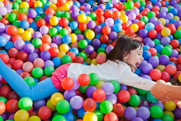 Fototapeta na wymiar little children on the background of many small balls