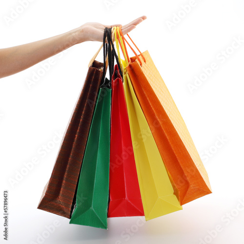 Photo Stands Colorful shopping bags set in woman's hand