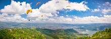 Paraglider Flying Against The ...