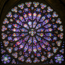 Rose Stained Glass Window In Cathedral Of Notre Dame, Paris, France