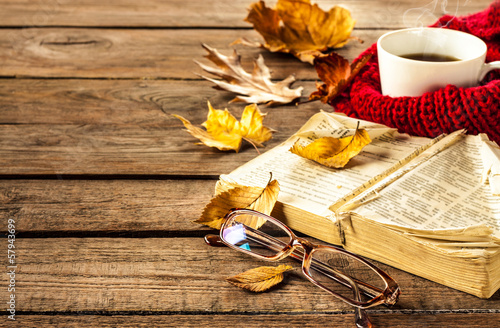 Foto op Canvas Herfst Hot coffee, book, glasses and autumn leaves on wood