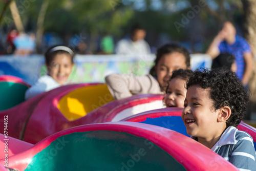 Poster Amusementspark Happy Young Children at Amusement Park