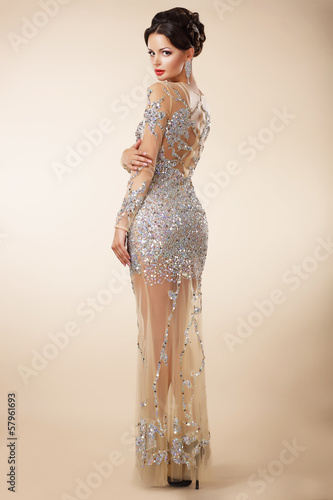 Foto  Well-dressed Respectable Woman in Evening Cocktail Dress