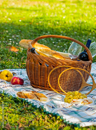 Keuken foto achterwand Picknick picnic basket with bread, fruit and cheese