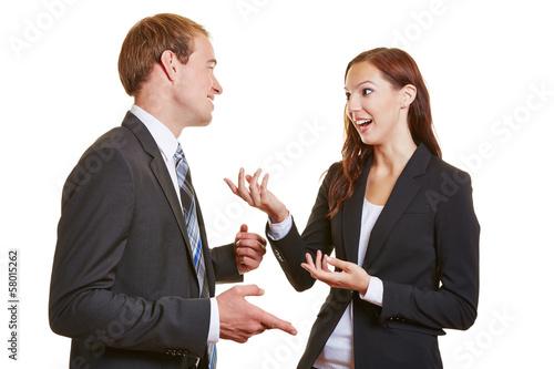 Fotografie, Obraz  Zwei Geschäftsleute reden miteinander