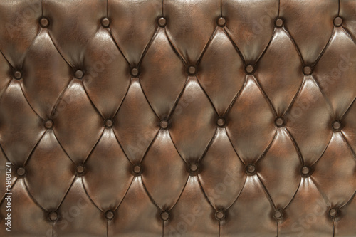 Fotografía  Superficie tapizada de cuero marrón acolchado