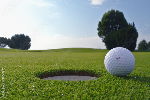 Spoed Foto op Canvas Golf golf hole and ball