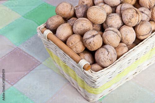 Spoed Foto op Canvas Baobab walnuts in a wicker basket
