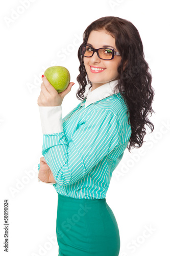 Fotografija  smiling brunette girl in green skirt and blouse holding apple