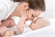 Leinwandbild Motiv Portrait of happy mother and baby