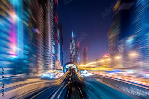 Staande foto Midden Oosten Dubai metro railway in motion blur