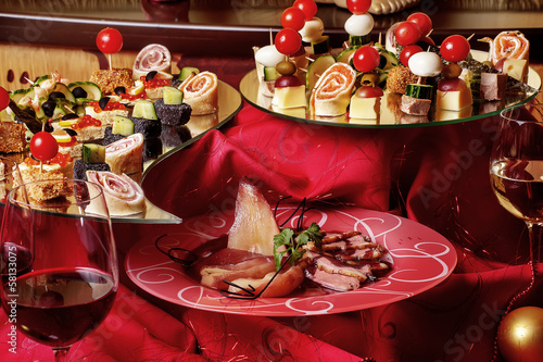 Foto op Canvas Voorgerecht Delicious canapés and snacks for wine on the holiday table