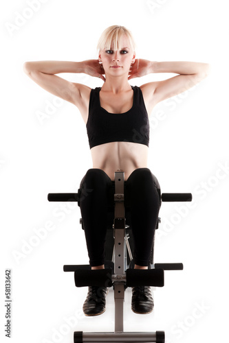 Fotografering  sports girl doing exercises on a press