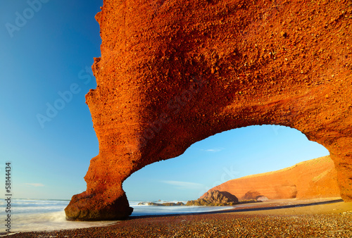 Red archs on atlantic ocean coast. Morocco