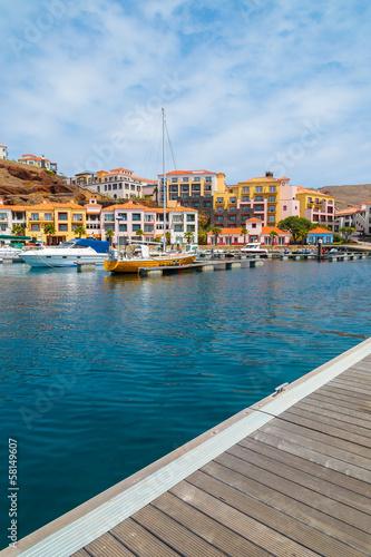 Foto op Aluminium Stad aan het water Wooden pier in marina with yacht boats mooring on Madeira island