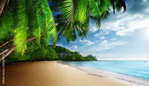 Foto auf Gartenposter Strand sunset on beach Anse Takamaka of Mahe island, seychelles