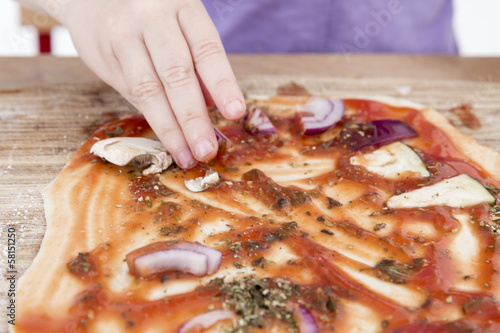 Fotografie, Obraz  small hands preparing pizza