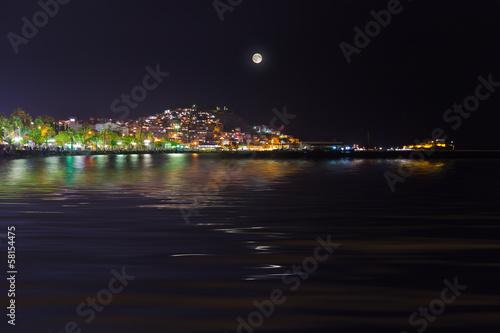 In de dag Volle maan Night view of Kusadasi Turkey