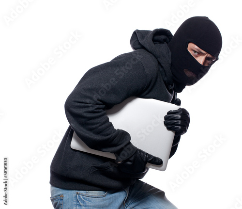 Fotografía Thief stealing a laptop computer