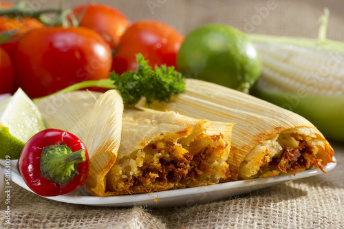 Photo  Mexican tamales on plate.