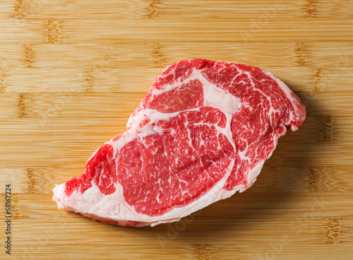 Fotografiet Raw aged beef ribeye steak
