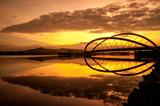 Modern bridge by the lakeside in Putrajaya, Malaysia at sunrise