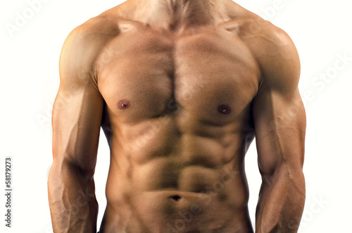 Close up on perfect abs. Strong bodybuilder with six pack Canvas Print