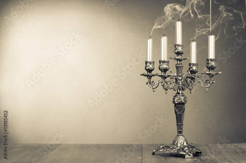 Vintage candelabrum with five reek candles sepia photo