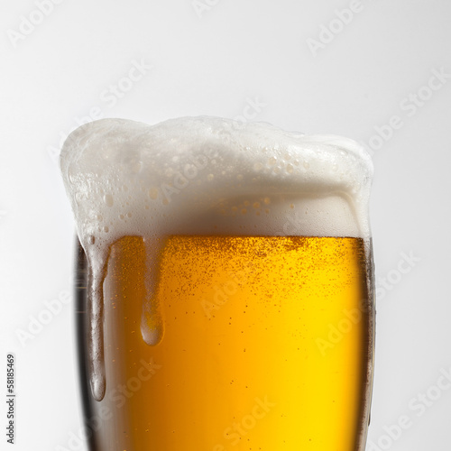 Beer in glass isolated on white background Poster