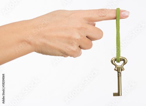Fototapeta Hand hold old key isolated on white obraz na płótnie