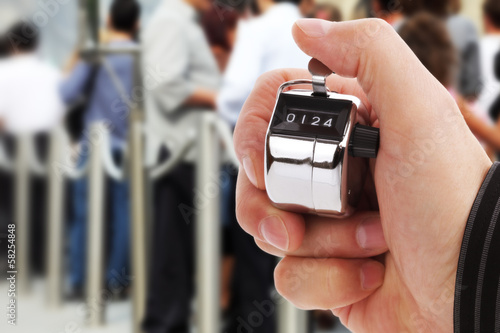 Photo  Counting people headcount on tally counter