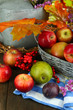 Juicy apples in basket on table close-up