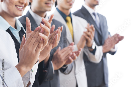Photo Business executives applauding