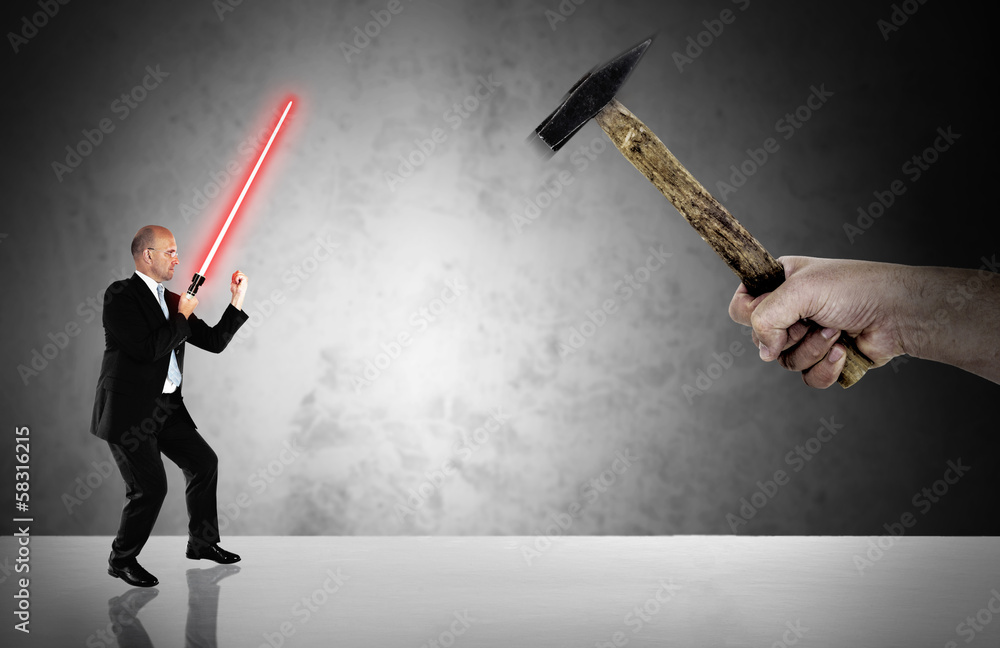Photo  Businessman fighting  with a laser-sword - business challenge