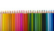 Close-up of colored pencils in a row