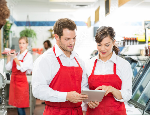 Butchers Using Digital Tablet At Store Poster Mural XXL