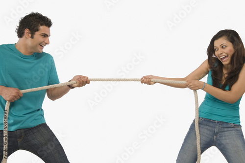 Fotografie, Obraz  Young couple playing tug of war
