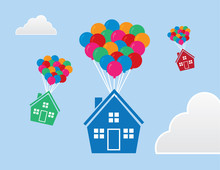 Houses With Balloons Floating Through The Sky