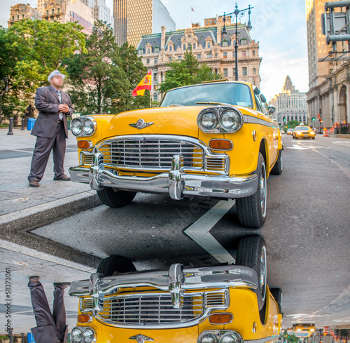 Poster New York TAXI Vintage yellow taxi in New York streets with driver waiting for