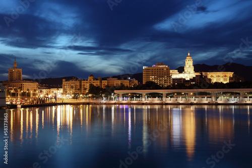 City of Malaga illuminated at dusk. Andalusia, Spain