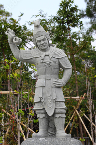 Photo  Warrior statue at the Po Lin Monastery in Hong Kong
