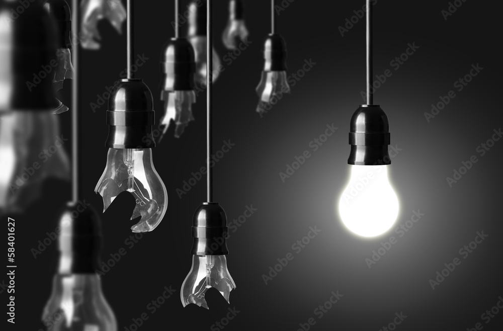 Fototapety, obrazy: idea concept with broken bulbs and one glowing bulb