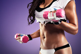 Woman with flat and sexy stomach exercising - 58442636