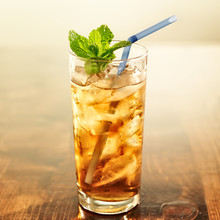 Golden Iced Tea With Blue Straw And Mint