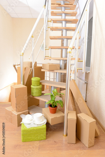 Stack Of Cartons Near Stairs Moving House Concept Buy This Stock